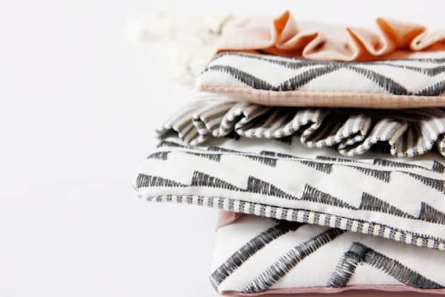 ruffle zip pouches with decorative stitching