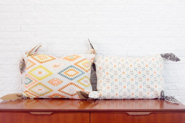 knotted corner pillows with wanderer fabric