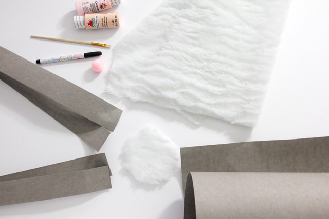 DIY Bunny Basket | See Kate Sew Made with kraft tex and lined with fur!