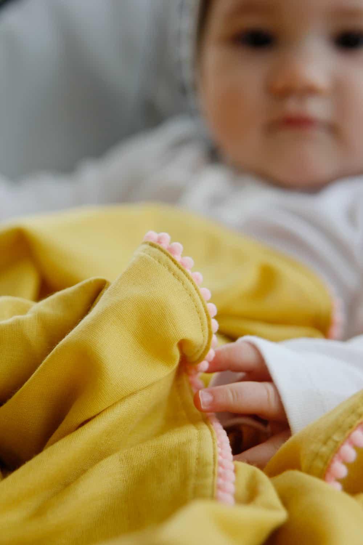 diy pom pom swaddle blanket see kate sew