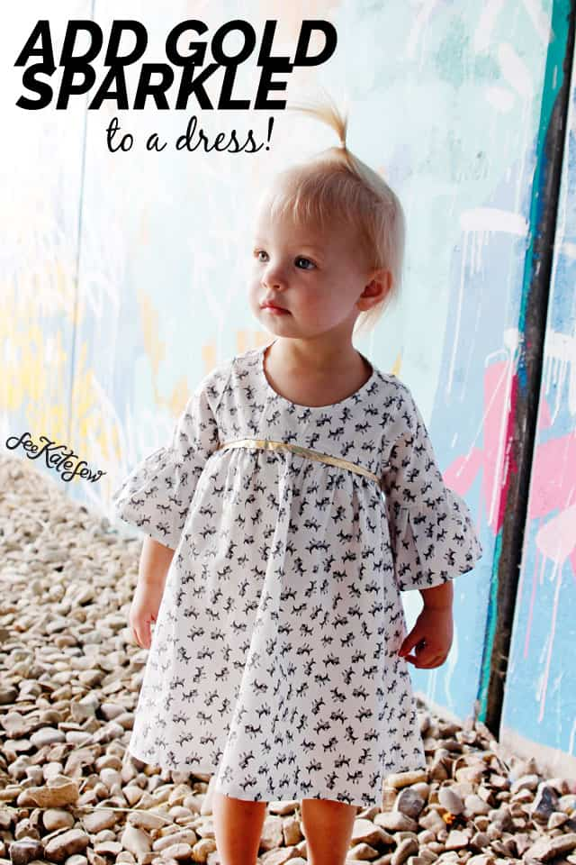 Add Gold Sparkle to a Dress! | DIY Girls Dresses | DIY Girls Dresses with Gold Sparkle | Emma Dress Pattern | Riley Blake Fabric Tour | Petite Treat Cat Dress | How to Sew Girls Dresses | Girls Dress Pattern | How to Add Bias Tape to a Dress || See Kate Sew #girlsdresses #diygirlsdresses #diykidsclothes #rileyblake #petitetreat #biastape #goldsparkle #seekatesew
