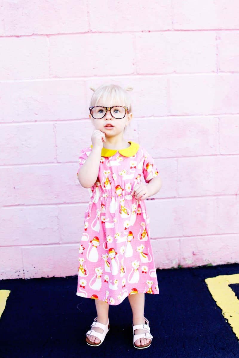 The Olivia Dress sewing up in gorgeous quilting cotton with a bright yellow collar to match! Simple lines with a few really cute features! Simple to get on your kiddo, the waistline is elastic and it just slips right on! Plus...Pockets! || See Kate Sew #dresspatterns #kidsfashion #dresses #seekatesew