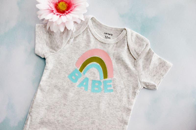 Make this easy Rainbow Baby Onesie with a blank onesie and this free SVG file. Choose a cute onesie with 3 colors of iron-on vinyl and you have a perfect gift for a sweet rainbow baby or your own sweet rainbow babe! || See Kate Sew #rainbowbaby #babyonesies #cricutprojects #freesvg #seekatesew