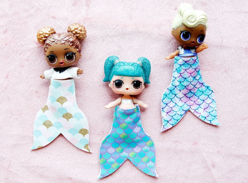 Summertime is for MERMAIDS! This is a super fun craft that is perfect for a summer afternoon! These mermaid tails for dolls are faux leather glued together so they are very fast so your kids can get right to playing! || See Kate Sew #mermaidtails #mermaidcraft #loldollaccessories #dollaccessories #seekatesew