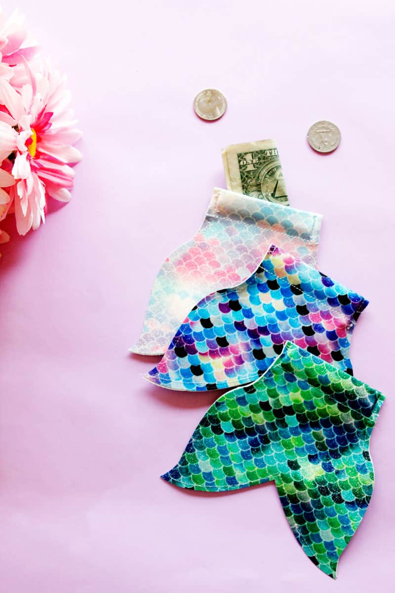 This DIY Mermaid Snap Coin Pouch is easy to open and perfect for stashing coins. It's super fun and easy, and the mermaid tail shape is perfect for your pool bag.    See Kate Sew #coinpouch #mermaidcrafts #freesvg #freetutorial #cricutcrafts