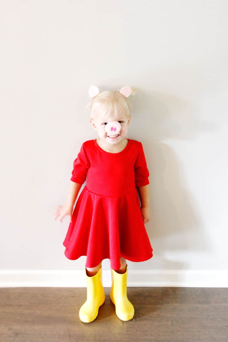 This Peppa Pig costume DIY is perfect for Halloween and dress-ups after! Starting with a basic red dress and add a few little pig accessories, you will love how easy this costume is to make! || See Kate Sew #diycostumes #costumes #diypeppapig #peppapig #diyhalloween #freedownload #seekatesew