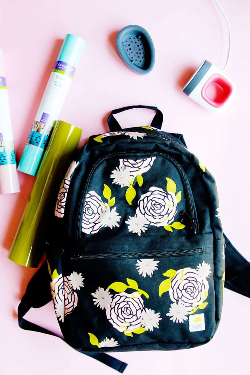 This FREE TUTORIAL on How To Iron-on Vinyl on a Backpack with the Cricut EasyPress 2 Mini will show you how to give an old backpack a revamp! || See Kate Sew #cricutcrafts #cricuttutorial #freetutorial #easypress2 #seekatesew