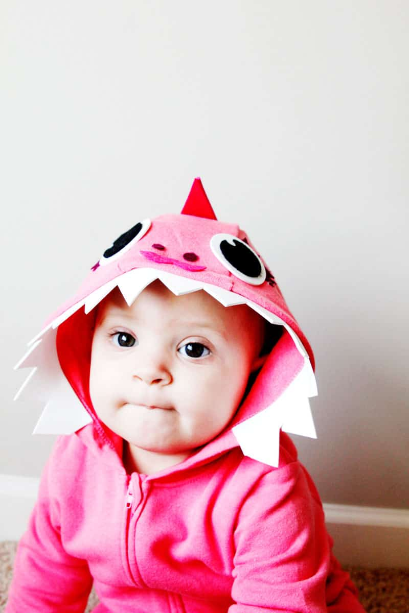 This Pink DIY Baby Shark Costume with a Hoodie is so easy to make! It's the perfect no-sew Halloween costume! || See Kate Sew #babyshark #diyhalloweencostume #babycostume #diycostume #easycostumes #seekatesew